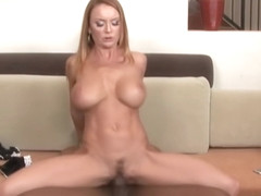 Experienced, red haired fuck doll, Janet Mason sucks black co