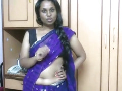Hot Indian maid teasing while working on saree