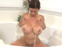 Curvaceous woman with big boobs, Alexis Fawx is playing with herself while in the bath tub