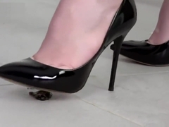 Linda crushing roaches under sharp black leather high heels.