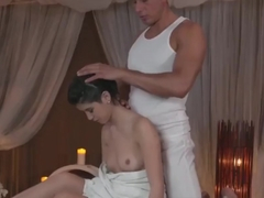 Oiled massage beauty fucked on massage table