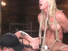 Busty muscled stomach slave tormented