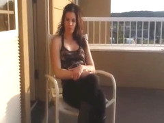 Brunette MILF gives blowjob on the balcony in a POV video