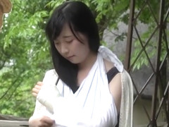 Japanese girl unwraps bandage from her injured ankle