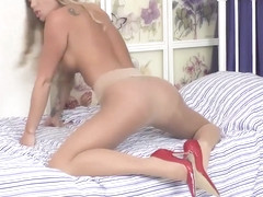 Hottie Natalia Forrest fucks sex toy in heels and sheer seamless pantyhose