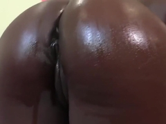 Noemie Bilas oils up her silky smooth body
