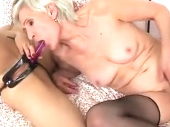Two Short-Haired Lesbians Enjoy Licking Each Other's Nice...