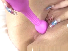 Mature Louise Bassett Uses a Purple Toy on Her Pussy