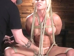 Hogtied busty blonde banged dick on a stick