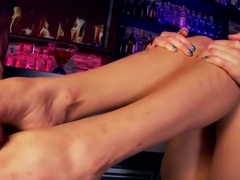 Babe gives footjob in bar