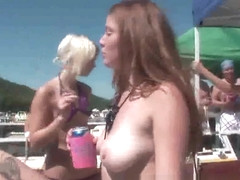 Group of sexy topless babes dancing on a boat