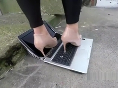 Laptop crushed stamped on and destroyed in High heels