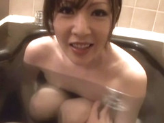 Hot mature Japanese AV model enjoys a bath and a blowjob
