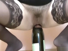 Anal rider on a bottle, pushed on an ass on a bottle, young brunette