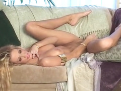 Beautiful Jessica D pleasures herself with a golden dildo