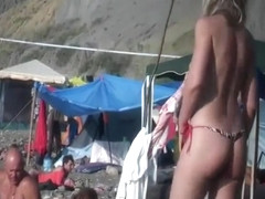 Topless babe voyeured on a beach