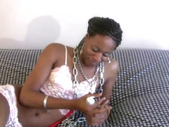 Bashful ebony TS in lingerie fucks her anal with dildo