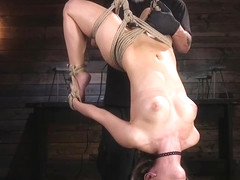 Long haired slave in rope hogtie suspension