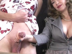 Experienced woman is giving a gentle handjob to a handsome guy, in front of the camera