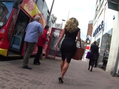 Sexy Blonde Business Woman in Tight Black Dress