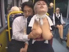 Busty stewardess gives handjob on bus, takes cumshot