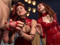 Girls in red latex dresses ballbusting a disgusting latex-dress-freak