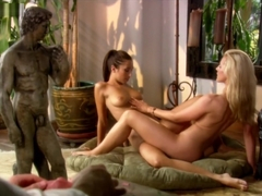 Divini Rae and Tiffany Taylor Erotic Traveler molded image lesbian scene