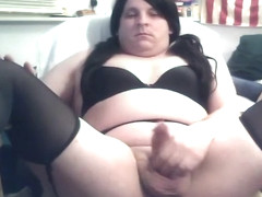 Cute cd with black lingerie rubs her cock