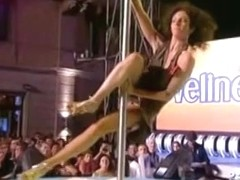Pole dancing brunette showing some spectacular skills
