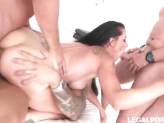 Black haired woman, Texas Patty is wearing only sandals with high heels while getting doublefucked