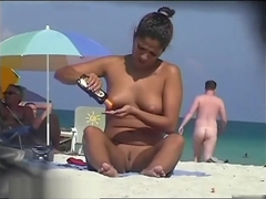 Beach girl nudist spreading her legs and showing off her sweet wet pussy