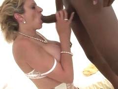 Lady Sonia is a dirty minded, blonde woman in black stockings, who likes to fuck black guys