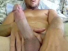 Charming dude is having a good time in his room and shooting himself on webcam