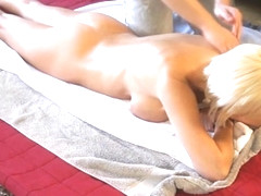 Busty Jan Burton gets a massage