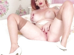 Busty redhead strips off white lingerie wanks in nylons heels