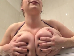 Astonishing woman, Samantha Lily is soaping her massive milk jugs in front of the camera