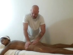 Ebony MILF massaged & finger banged by muscled masseur