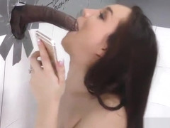 Brunette sucks throbbing black cock