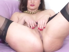 Busty brunette Eva Johnson strips wanks in sheer nylon heels