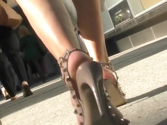 Woman Walking In High Beige Studded Sandals