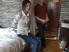 asian bondage medical tape and ball gagged