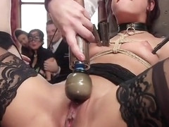 Muscled man banging babes at bdsm party