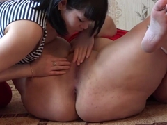 A girlfriend fucks a lesbian in the mouth and in a shaved hole, licking a fat pussy.