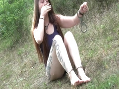 Outdoor hogtie cuffed in swimsuits