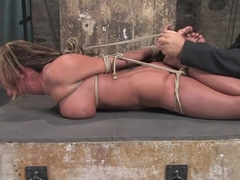 Huge breasted Trina Michaels tightly bound in bondage