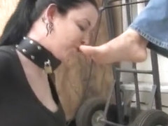Young slave obediently licks rubber Converse sneakers