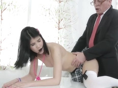 Slutty brunette schoolgirl in a mini skirt is getting her tight, pink pussy drilled by a teacher