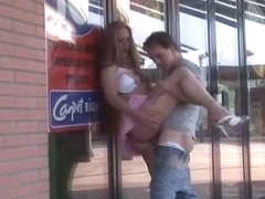 Young stud bangs slut against store window