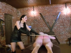 Leather mistress canes her slaves sorry ass