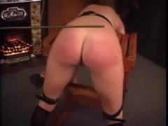 retro_spanked and caned on her stunning ass